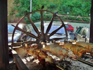 Meat roasting slowly over a fire spit filled the air of the Jablanica's hills